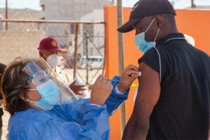 A migrant is vaccinated in Tijuana last month.