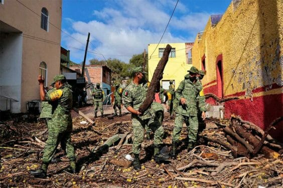 Soldiers clean up after last week's flooding in Zacatecas.