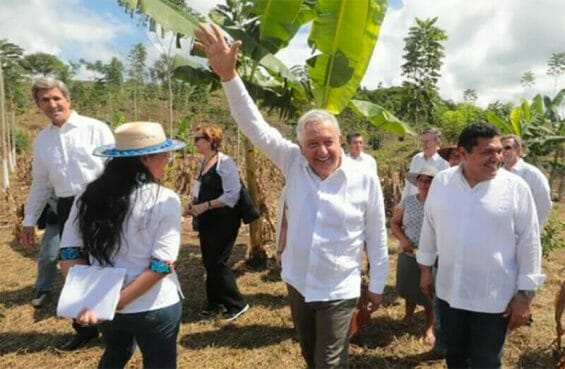 The president waves to onlookers during a visit to Chiapas Monday