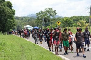 A group of migrants makes their way through Chiapas on a hot day in August of this year.