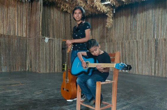 Young musicians on stage at El Tecolote.