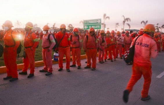 Workers line up for their shift at the Tabasco refinery.