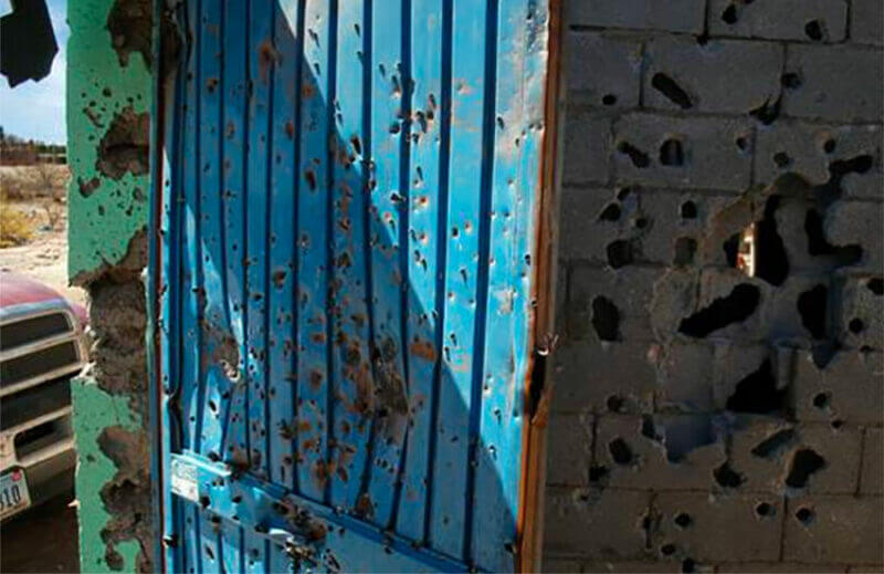 bullet holes in a wall